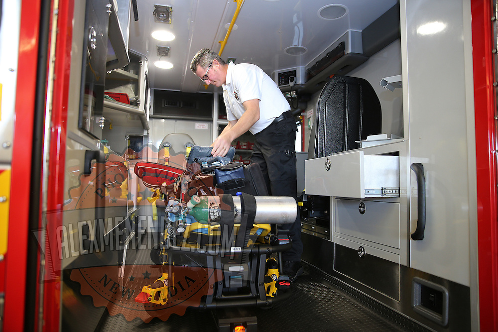 Captain Andrew Isaacs of the Winter Park Fire/Rescue Department prepares the interior of an ambulance prior to cleansing it with the built-in decontamination unit, coming in the wake of an international Ebola virus scare. The units are made up of pressurized pumps, which release a decontamination mist inside the patient area of the ambulance. It takes about 15 minutes for the mist to cover all the surface area inside – a process that can be done even while the ambulance is moving. This is one of three units on hand at the Winter Park, Florida station on Friday, Oct. 10, 2014 in Winter Park, Florida. (AP Photo/Alex Menendez)