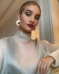 """Rosie Huntington-Whiteley releases a photo on Instagram with the following caption: """"To celebrate the launch of the new lip-loving, vegan BAREPRO Longwear Lipstick, I am kicking off the @bareminerals Chain of Good, which encourages all of us to share a little positivity by tagging someone who has been a force of good in your life. From January 16 through January 21, for the first 1000 Instagram posts with the hashtag #GoodThatLasts, bareMinerals will donate $10 for each post to women\u2019s charities that encourage mentorship, entrepreneurialism and education. \ud83d\udda4 I am tagging my fellow @bareminerals ambassador @haileybieber who is as beautiful on the inside and she is on the outside. Keep the chain going! #GoodThatLasts #PowerOfGood"""". Photo Credit: Instagram *** No USA Distribution *** For Editorial Use Only *** Not to be Published in Books or Photo Books ***  Please note: Fees charged by the agency are for the agency's services only, and do not, nor are they intended to, convey to the user any ownership of Copyright or License in the material. The agency does not claim any ownership including but not limited to Copyright or License in the attached material. By publishing this material you expressly agree to indemnify and to hold the agency and its directors, shareholders and employees harmless from any loss, claims, damages, demands, expenses (including legal fees), or any causes of action or allegation against the agency arising out of or connected in any way with publication of the material."""