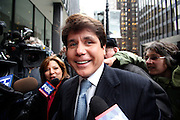 Rod Blagojevich, former governor of Illinois, is all smiles as he enters the Dirksen Federal Building April 14, 2009, for his arraingment in federal court on numerous corruption charges.<br /> Photograph: JohnZich/Bloomberg News