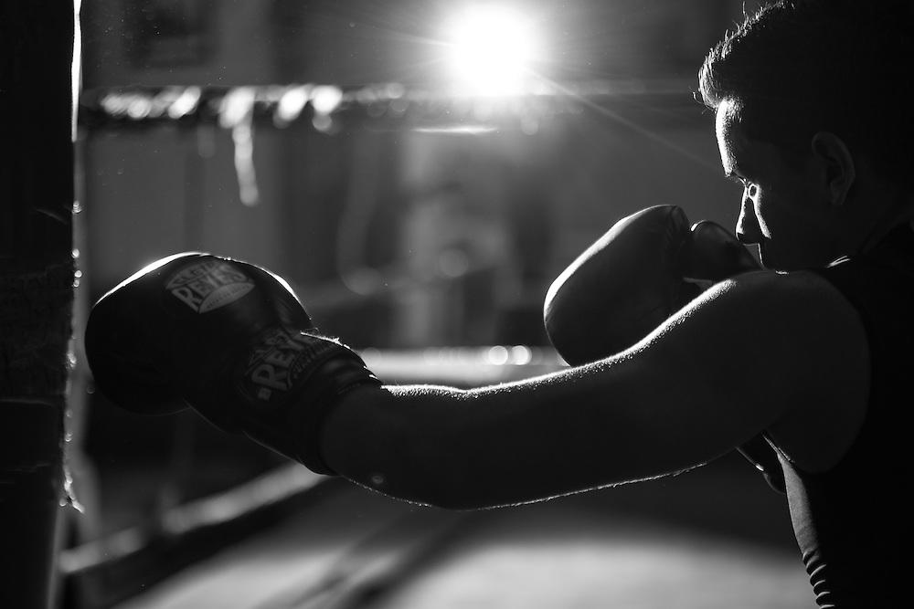 Jordon Montoya warms up on the bag at La Habra Boxing Club.<br /> Sports Shooter Academy XI:  La Habra Boxing Club on November 06, 2014 at La Habra in La Habra CA, USA.  Photo credit: Jason Tanaka