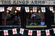 St George's Day flags fly outside the Kings Arms on London Wall, the City of London during the lunchtime of 23rd April, England's national day.