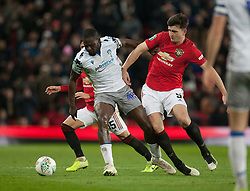 Frank Nouble of Colchester United (C) and Harry Maguire of Manchester United in action - Mandatory by-line: Jack Phillips/JMP - 18/12/2019 - FOOTBALL - Old Trafford - Manchester, England - Manchester United v Colchester United - English League Cup Quarter Final