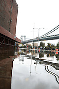 October 30, 2012- Brooklyn, NY: The Day After Sandy ravages the New York City Area, New Yorkers move forward and begin the clean-up process and get back to normal. These images were made on October 30, 2012 in the Dumbo, Brooklyn Heights and Prospect Park Section of Brooklyn, NY. The Super Hurricane has ravaged parts of the New York City area where the storm has brought 23 serious fires to parts of Staten Island, Brooklyn, Queens as well as City Island and the Bronx, including the destruction of more than 80 houses in the Breezy Point section of the Rockaways.  (Terrence Jennings)