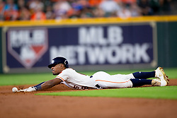 May 23, 2018 - Houston, TX, U.S. - HOUSTON, TX - MAY 23: Houston Astros center field Tony Kemp (18) slides into second base was tagged out by \San Francisco Giants second baseman Kelby Tomlinson (37) in the third inning during MLB baseball game between the Houston Astros and the San Francisco Giants on May 23, 2018 at Minute Maid Park in Houston, Texas. (Photo by Juan DeLeon/Icon Sportswire) (Credit Image: © Juan Deleon/Icon SMI via ZUMA Press)