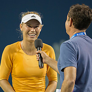August 16, 2014, New Haven, CT:<br /> Caroline Wozniacki is interviewed by host Andrew Krasny after a match against Timea Bacsinszky on day four of the 2014 Connecticut Open at the Yale University Tennis Center in New Haven, Connecticut Monday, August 18, 2014.<br /> (Photo by Billie Weiss/Connecticut Open)