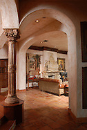 High arches frame the front entry and living room of a mansion in the exclusive, lakefront community of Lake Nona in Orlando, Florida.