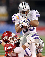 Kansas State running back John Hubert (33) tries to run to the outside as he is tackled by Arkansas cornerback Tevin Mitchel (8) during the 2012 AT&T Cotton Bowl, Friday, Jan. 6, 2012, in Arlington, Texas.