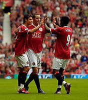 Photo: Jed Wee.<br />Manchester United v Seville. Pre Season Friendly. 12/08/2006.<br /><br />Manchester United's Louis Saha (R) scores and runs to the supplier of the vital pass, Cristiano Ronaldo (L) and John O'Shea to celebrate.