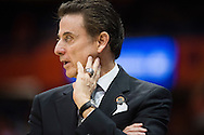 27 MAR 2015: Coach Rick Pitino of the University of Louisville observes his players against North Carolina State University during the 2015 NCAA Men's Basketball Tournament held at the Carrier Dome in Syracuse, NY. Louisville defeated North Carolina State 75-65. Brett Wilhelm/NCAA Photos
