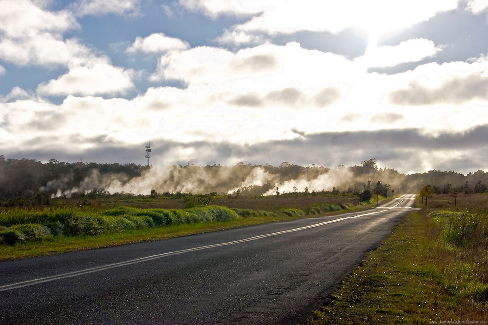 Morning Sun burns through the clouds and illuminates the steam from the depths of the earth, Volcanoes National Park, Hawaii