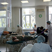 Military leaders of the self-proclaimed Donetsk People's Republic donate blood at a blood bank in Donetsk.