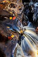 Rapids over maple leaves in the Escanaba River near Palmer, Michigan, USA