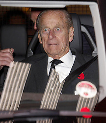 The Duke of Edinburgh reacts to a blast from the ship's fog horn as he leaves after a visit to the QE2 in Southampton docks.