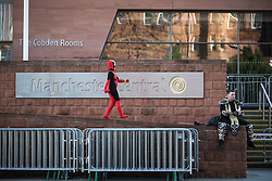 © Licensed to London News Pictures . 25/07/2015 . Manchester , UK . Visitors to Comic Con on the streets of Manchester after venue - Manchester Central's - doors are shut . Photo credit : Joel Goodman/LNP