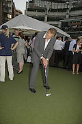 MIKE DUNHILL, Alfred Dunhill Million Dollar Putt, the Dunhill Clubhouse. Broadgate Arena.London EC2. 25 July 2006.  ONE TIME USE ONLY - DO NOT ARCHIVE  © Copyright Photograph by Dafydd Jones 66 Stockwell Park Rd. London SW9 0DA Tel 020 7733 0108 www.dafjones.com
