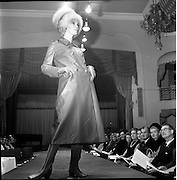 13/11/1967<br /> 11/13/1967<br /> 13 November 1967<br /> Irish Leather Federation, Leather Fashions at the Gresham Hotel, Dublin.<br /> Brown maxi length Leather coat by Morel.