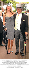 Singer ROD STEWART and MISS PENNY LANCASTER, at Royal Ascot on 18th June 2003.PKP 20
