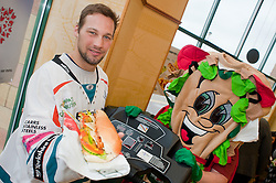 """Sheffield Steelers Ben Simon and Subman take tot the treadmill with one of the """"Healthier Way"""" range of Subs at Centertainment Sheffield Branch.26  October 2010 .Images © Paul David Drabble"""