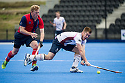 Wimbledon's Henry Weir passes while under pressure from Rupert Shipperley of Hampstead & Westminster. Wimbledon v Hampstead & Westminster - Semi-Final - Men's Hockey League Finals, Lee Valley Hockey & Tennis Centre, London, UK on 22 April 2017. Photo: Simon Parker