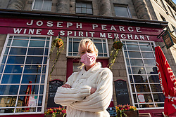 Edinburgh, Scotland, UK. 8 October 2020. Anna  Christopherson, owner of the Boda Bars, stands in front of her pub, Joseph Pearce on Elm Row. Ms Christopherson is angry and confused about the Scottish Government's plans to close pubs from Friday. She says she is is unable to make any plans, for either food and beverage or staffing,  to allow her business to continue when cannot understand the rules being issued by the Scottish Government. The confusion is leading to desperation amongst bar owners as they face a very uncertain future, she says. Iain Masterton/Alamy Live News