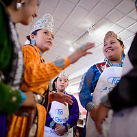 020715       Cable Hoover<br /> <br /> Ch'ooshgai Community School junior princess Taya Tom, center, watches as Miss Navajo Nation McKeon Dempsey gives directions to other royals during the Tip A Royalty fundraiser at Earl's Restaurant in Gallup Saturday.