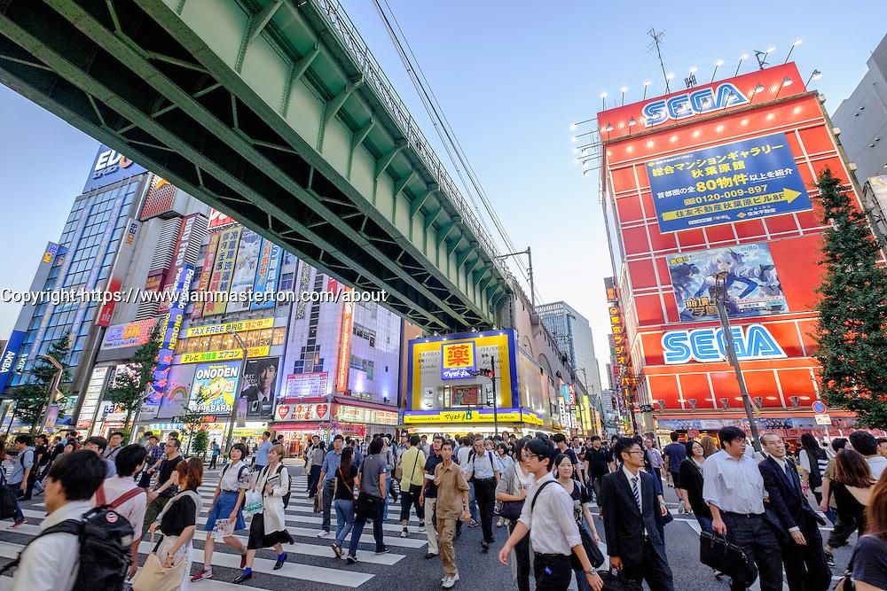 Busy pedestrian crossing in Akihabara known as Electric Town or Geek Town selling Manga based games and videos in Tokyo Japan