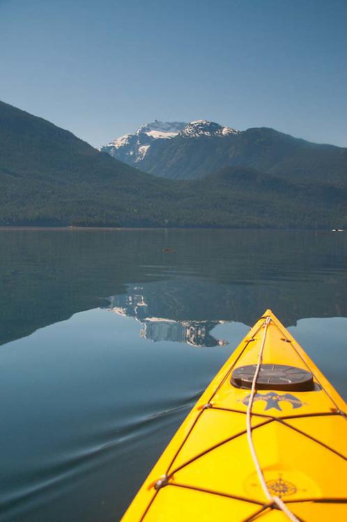 Yellow Kayak on Ross Lake Facing Jack Mountain and Nohokomeen Glacier, Ross Lake National Recreation Area, North Cascades National Park, Washington, US