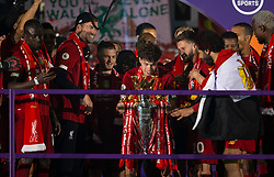 LIVERPOOL, ENGLAND - Wednesday, July 22, 2020: Liverpool's Neco Williams lifts the Premier League trophy during the presentation as the Reds are crowned Champions after the FA Premier League match between Liverpool FC and Chelsea FC at Anfield. The game was played behind closed doors due to the UK government's social distancing laws during the Coronavirus COVID-19 Pandemic. (Pic by David Rawcliffe/Propaganda)