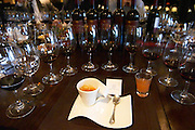 Coffee and digestive in a designer cup to end an opulent lunch, in the background Glasses lined up for a vertical tasting, bottles of Angel A Mendoza Malbec Cabernet Sauvignon Pura Sangre Domaine St Diego Lunlunta Maipu Mendoza The O'Farrell Restaurant, Acassuso, Buenos Aires Argentina, South America