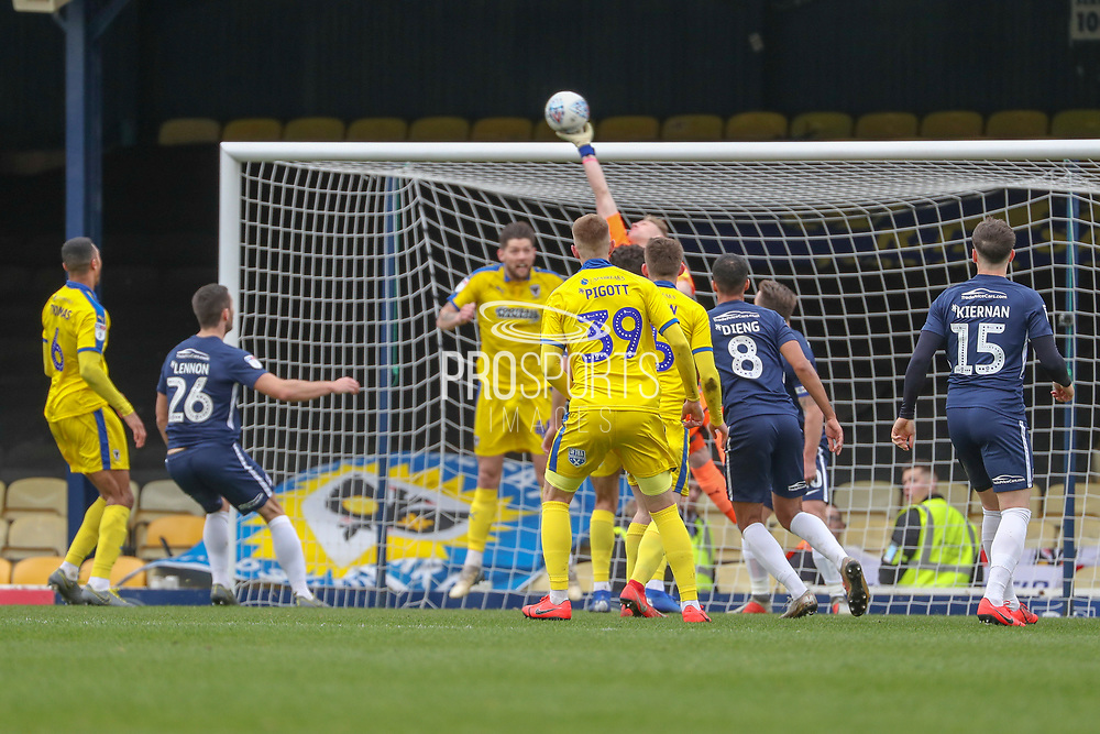 AFC Wimbledon striker Joe Pigott (39) watching AFC Wimbledon goalkeeper Aaron Ramsdale (35) save shot and tip over the bar during the EFL Sky Bet League 1 match between Southend United and AFC Wimbledon at Roots Hall, Southend, England on 16 March 2019.