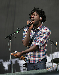 Kele Okereke (lead vocals, rhythm guitar) of British indie rock band Bloc Party, plays on the Main Stage at T in the Park, Friday 6 July 2007..T in the Park festival took place on the 6th, 7th and 8 July 2007, at Balado, near Kinross in Perth and Kinross, Scotland. This was the first time the festival had been held over three days..Pic ©2011 Michael Schofield. All Rights Reserved..