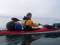 A kayaker passing by