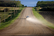 © 2008 Randy Vanderveen, all rights reserved.Grande Prairie, Alberta.A pickup kicks up a cloud of dust on a rural road near LaGlace, Alberta.