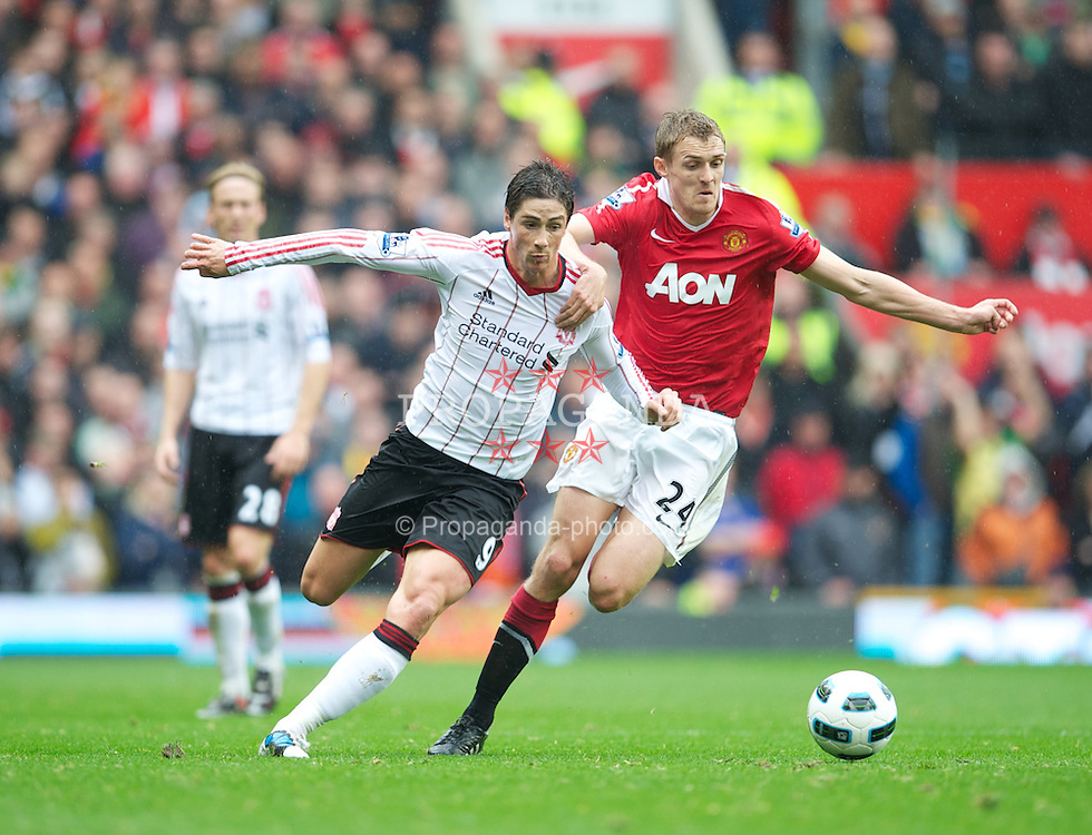 MANCHESTER, ENGLAND - Sunday, September 19, 2010: Liverpool's Fernando Torres and Manchester United's Darren Fletcher during the Premiership match at Old Trafford. (Photo by David Rawcliffe/Propaganda)