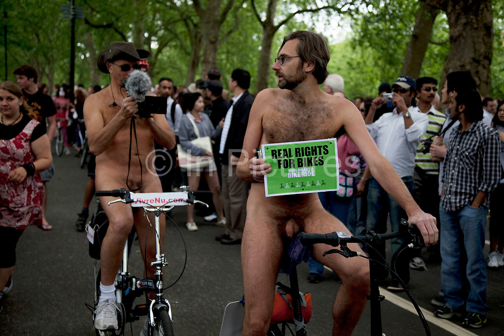 World Naked Bike Ride taking place in London. A peaceful, imaginative and fun protest against oil dependency and car culture. A celebration of the bicycle and also a celebration of the power and individuality of the human body. A symbol of the vulnerability of the cyclist in traffic. The world's biggest naked protest: 50+ cities and thousands of riders participate worldwide, including around 1500 in London.