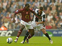 Photo: Leigh Quinnell.<br /> West Bromwich Albion v Arsenal. The Barclays Premiership.<br /> 15/10/2005. Arsenals Emmanuel Eboue holds off West Broms Paul Robinson.