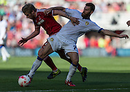 Leeds United FC striker Mirco Antenucci   retains the ball under pressure from Middlesbrough FC midfielder Adam Clayton during the Sky Bet Championship match between Middlesbrough and Leeds United at the Riverside Stadium, Middlesbrough, England on 27 September 2015. Photo by George Ledger.
