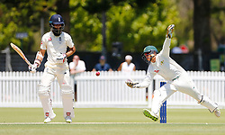England's Moeen Ali is attempted to be caught out by CA's Josh Philippe during day two of the Tour match at Richardson Park, Perth.
