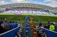 The teams emerge from the tunnel before lining up for a minute's applause as part of the tribute to Matt Grimstone and Jacob Schilt who were killed in the Shoreham air disaster during the Sky Bet Championship match between Brighton and Hove Albion and Hull City at the American Express Community Stadium, Brighton and Hove, England on 12 September 2015. Photo by Bennett Dean.