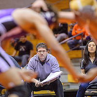 021514       Cable Hoover<br /> <br /> Miyamura head wrestling coach Marvin Gray, left,  and assistant coach Charlene Sekiya watch from the edge of the mat during the District 6-4A wrestling meet at Gallup High School Saturday.