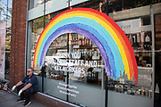 Rainbow for key workers as the Coronavirus lockdown measures are set to ease further, on Shaftesbury Avenue and the quiet city starts coming to an end on 22nd June 2020 in London, England, United Kingdom. As of today the government has relaxed its lockdown rules, and is allowing some non-essential shops to open with individual shops setting up social distancing queueing systems.