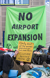 © Licensed to London News Pictures. 18/01/2019. Bristol Airport, Lulsgate, North Somerset, UK. Extinction Rebellion protest in the departure hall at Bristol Airport, to protest against plans to expand the airport and against frequent flying which they say causes both pollution and climate change. Molly Scott Cato, Green MEP for south west England, spoke in support. Photo credit: Simon Chapman/LNP