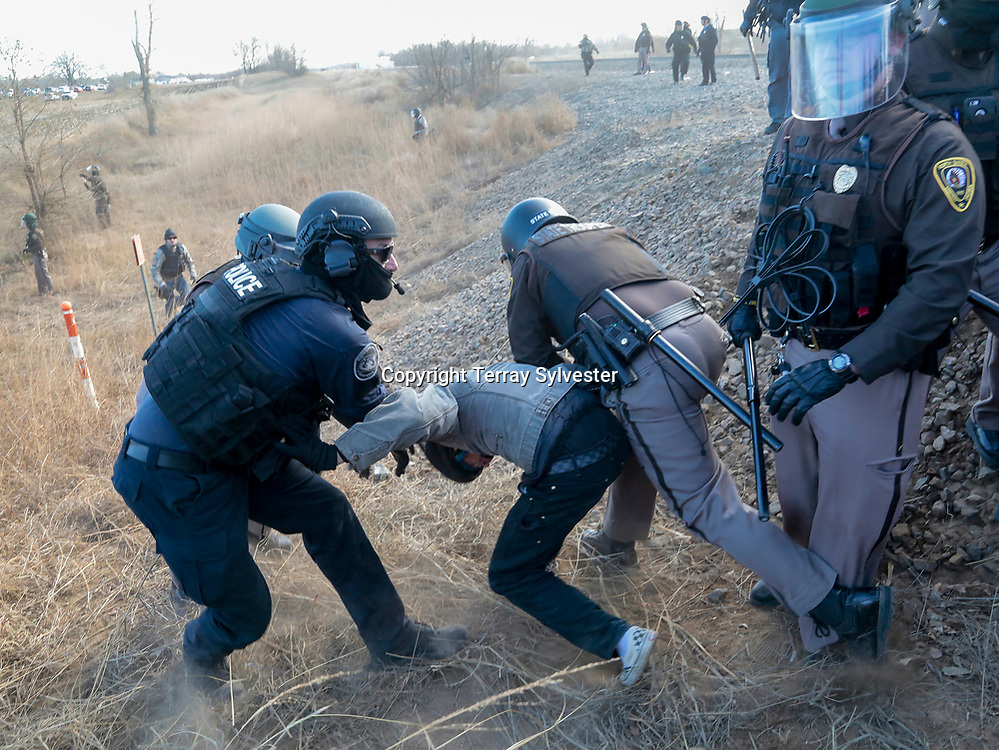 Police arrest an opponent of the Dakota Access oil pipeline during a demonstration near a pipeline construction staging area on Tuesday, November 15, 2016, on the outskirts of Mandan, North Dakota.