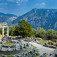 Delphi. Greece. View of the circular elegant Tholos with its three restored columns at the Sanctuary of Athena at Delphi. Dating from 390-380 BC, the round temple originally had twenty slim and graceful pentelic marble columns in Doric order on the outside.