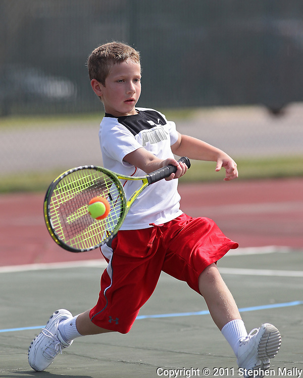 Carson Stecklein, 9, of Marion runs up to the ball during a Boys' 10 Singles match at the 2011 Baird Iowa Open tennis tournament at Westfield Tennis Club in Cedar Rapids on Wednesday, July 27, 2011. Over 200 players from Colorado, Illinois, Iowa, and South Dakota, participated in the event.