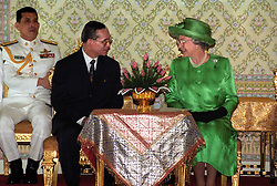File photo dated 28/10/96 of Queen Elizabeth II with King Bhumibol Adulyadej of Thailand (centre)following her arrival in Bangkok, as the Queen has become the world's longest reigning living monarch following his death.