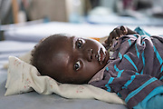 """Mcc0075406 . Daily Telegraph<br /> <br /> DT Foreign<br /> <br /> Lomong Latabo and her son Khamis 1.5 yrs old . They fled eastern Equatoria 1 month ago for Juba .<br /> <br /> The IMC Paediatric ward in POC 3 , a """"Protection of Civilian Camp"""" inside the vast UN compound on the outskirts of Juba . Parents bring their children in with acute malnutrition needing urgent treatment .<br /> <br /> Over 20,000 civilians who predominantly fled from conflict in the equatorial states of South Sudan . United Nation's agencies recently announced a famine in the war torn country .<br /> <br /> Juba 27 February 2017"""