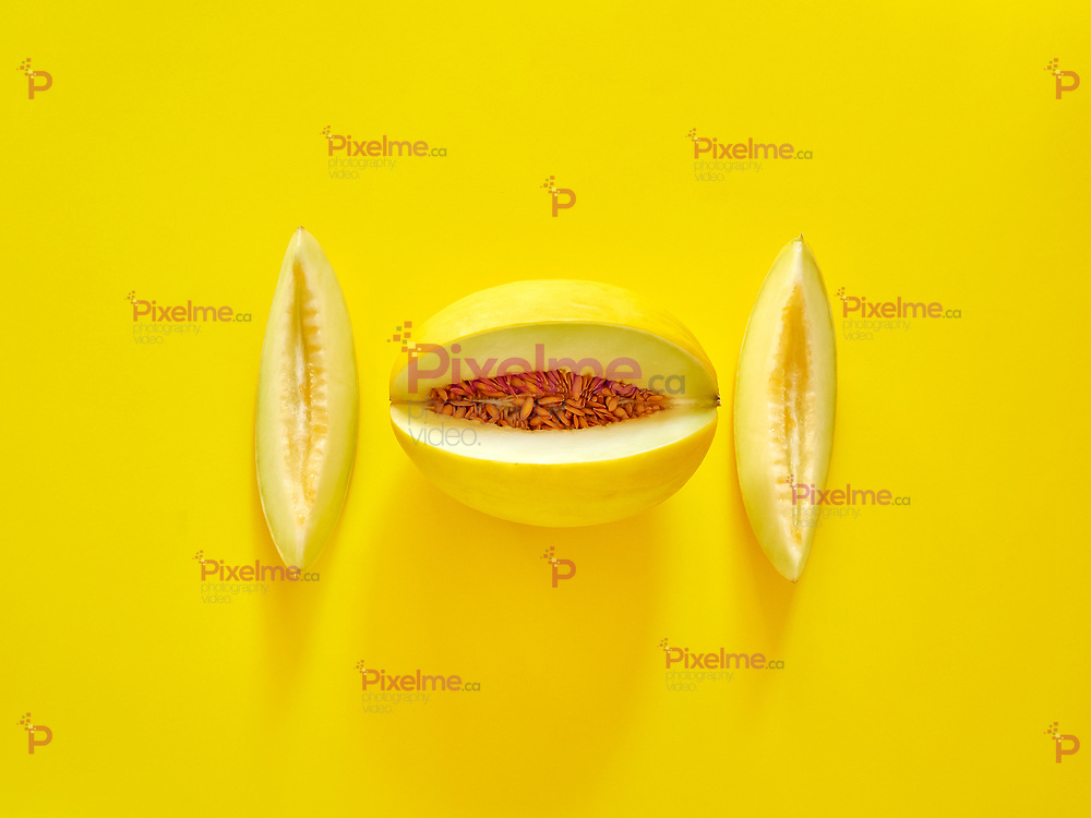 Yellow Melon Fruit isolated in yellow background viewed from above - flatlay look - Image Minimalism concept