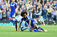 Chelsea's Willian is fouled by Man city's Fernandinho. Barclays premier league match, Manchester city v Chelsea at the Etihad stadium in Manchester,Lancs on Sunday 21st Sept 2014<br /> pic by Andrew Orchard, Andrew Orchard sports photography.