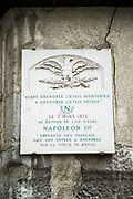 Plaque on cracked wall commemorating Napoleon return to Grenoble on 7 March 1815, Grenoble, France